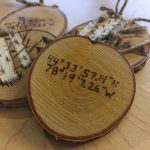 Birch tree slice ornaments with coodinates on back